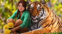 Magnifico fotomontaje con una chica abrazada por un tigre